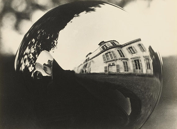 Man RayLOT 1155 | $ 6.500 - 9.100 / € 5.000 - 7.000Untitled (Reflections in a Car's Headlights), 1932 1940s, Vintage, Gelatin silver printAgfa paper, Mat. 21,3 x 29 cm