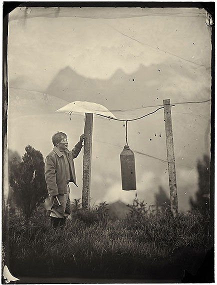 Luo Dan: Simple Song No. 25, John ringing the bell, Laomudeng Village, 201030 x 21cm - Edition of 20; 147.3 x 111.8cm - Edition of 8, Pigment Print on Fiber Paper © Luo Dan