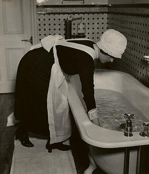 Parlourmaid Preparing a Bath before Dinner, c. 1937© Bill Brandt Archive Ltd.Courtesy Edwynn Houk Gallery