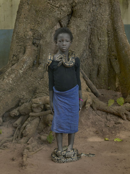 Nahaume Ouielle, 8 ans, with Daba Dre Snakes, Temple Des Pythons, Ouidah, Benin, 2011 © Albert Watson