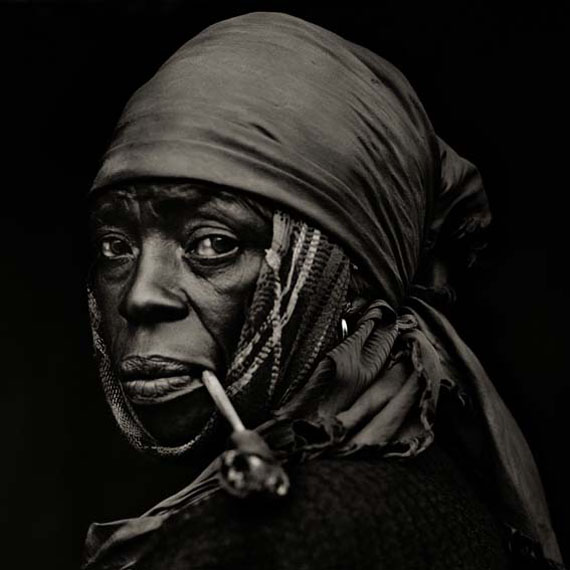 Dana Gluckstein, Woman with pipe, Haiti, 1983, Archival Pigment Photograph printed on Moab Entrada paper , 71 x 71 cm (28 x 28 inches)