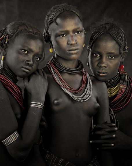 © JIMMY NELSON, BODITA, ARBOSHASH & NIRJUDA, DASSANECH TRIBE OMORATE VILLAGE, SOUTHERN OMO VALLEY, ETHIOPIA, 2011