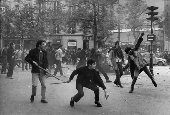 BRUNO BARBEYMay 1968, Paris. 6th arrondissement. Boulevard Saint Germain. Students hurling projectiles against the police.Vintage Print11.8 x 14.1 inches© Bruno Barbey / Magnum Photos