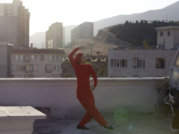 A female performer practicing on a roof overlooking the capital, Tehran has a vibrant theatre scene, which many use as a way to criticize society. © Newsha Tavakolian