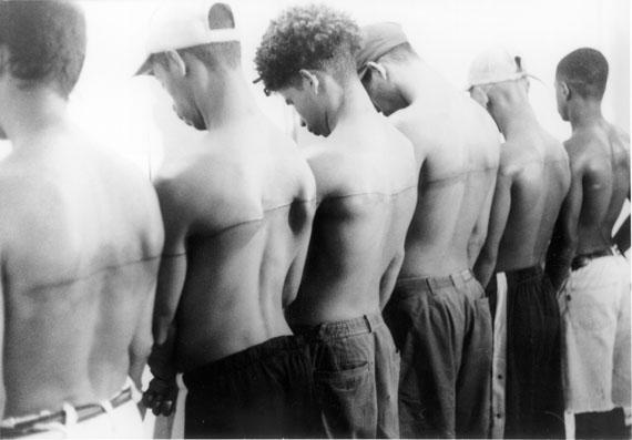 Santiago Sierra: 250 cm line tattooed on 6 paid people Espacio Aglutinador, Havana/Cuba, December 1999, 1999