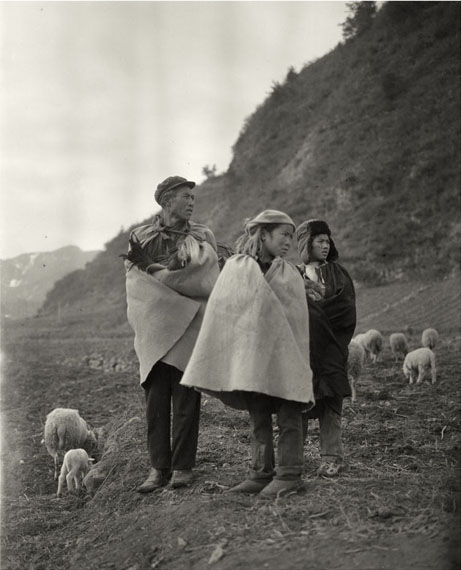 Family Holding Chickenfrom the