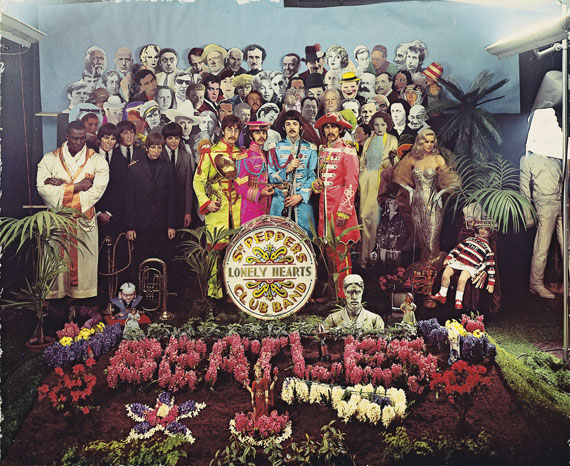 MICHAEL COOPER, Sergeant Pepper's Lonely Hearts Club Band, 1967, dye-transfer print | Estimate: $50,000 – 70,000• Sergeant Pepper's Lonely Hearts Club Bandis a pristine and unique print and is in a broader cropping than the album cover showing much 'behind-the-scenes' activity.  • In keeping with the lyrics of the title track, Paul's idea was that the group should be depicted as the kind of band that would play in a park bandstand. • This is the only known dye-transfer print of the image.