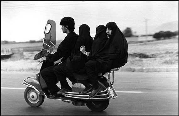 Young man, three veiled girls in a four-seater motorbike. Shahr Rey, Iran. 1997