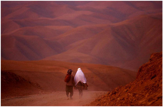 A couple went down the barren roads of Badakhshan province, North Afghanistan, 2001 © James Hill