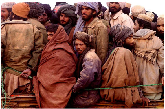 Taliban prisoners squeezed onto a truck in the desert, North Afghanistan, November 2001 © James Hill