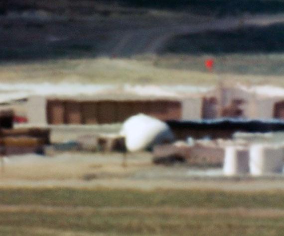 Trevor Paglen: Large Hangars and Fuel Storage; Tonopah Test Range, NV Distance ~ 18 miles; 10:44 a.m., 2005© the artist, Courtesy Galerie Thomas Zander, Köln