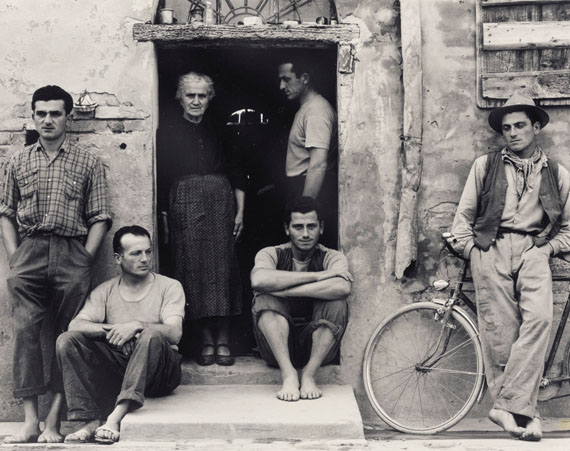 Lot 83Paul Strand (1890-1976)The Family, Luzzara, Italy, 1953gelatin silver print, flush-mounted on cardsigned, titled, dated in ink with printer's notations and various numbers in other hands in pencil (flush mount, verso)image: 7.1/2 x 9.1/2 in. (19 x 24.2 cm.)sheet/flush mount: 7.3/4 x 9.3/4 in. (19.7 x 24.7 cm.)$200,000-300,000