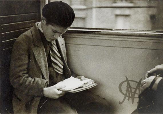 "Lot 61Andre Kertesz""Reading"", ca.1930, Vintage, gelatin silver,copyright mark on the reverse with the address: 32 bis, Rue du Cotentin, Paris11 x 15,5 cm"