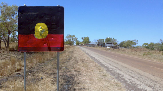 Brenda L Croft: NT Intervention sign, customised by John Leeman, Daguragu, 29 August 2011, from Sign of the times. Pigment print, 70 x 84cm