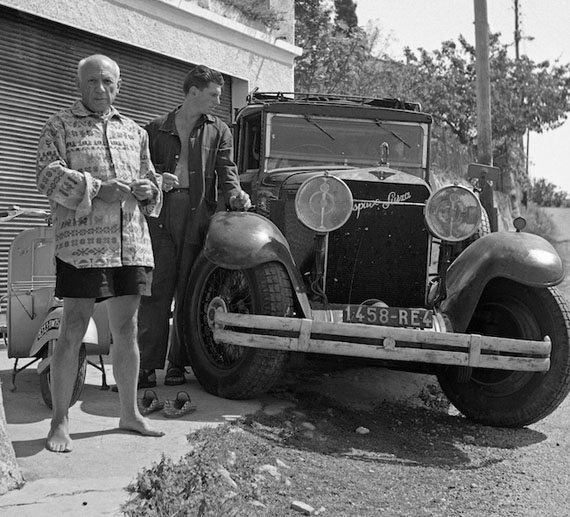 Pablo Picasso with his Hispano Suiza and his son Paul. Vallauris 1953