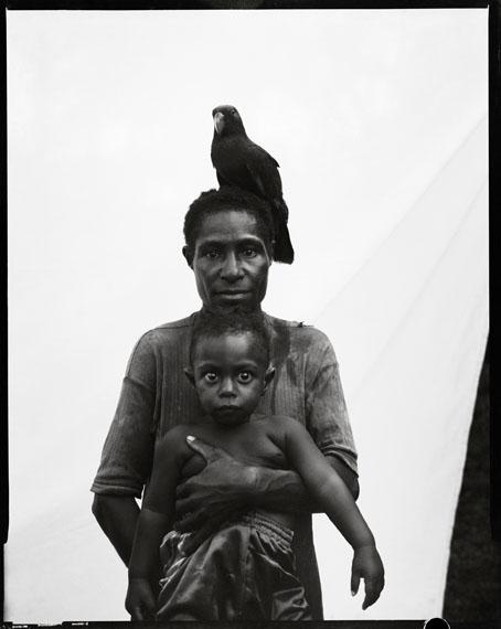 © Stephen Dupont Urista Korimbun and baby Bono Korimbun, Govermas Village, Middle Sepik, PNG, 2011. Silver gelatin print, 60.96 x 50.8cm.