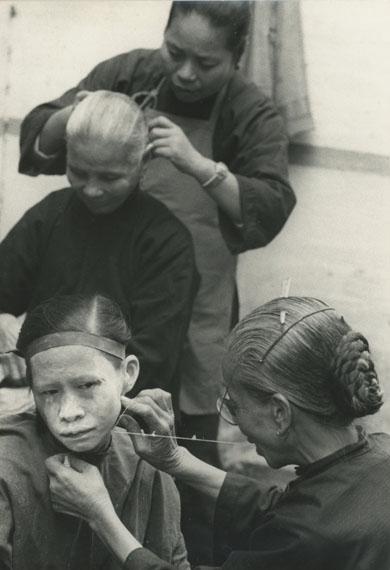Hiroshi HamayaWomen shaving hair, Guangzhou, China, 1956Vintage silver gelatin print29.5 x 19.9 cm© Hiroshi Hamaya EstateCourtesy Michael Hoppen Gallery
