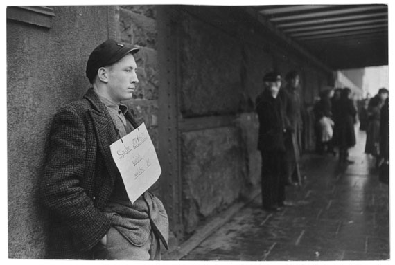 "Henri Cartier-Bresson, ""I am looking for any kind of work"", sign hanging around the neck of this young German, Hamburg, West Germany, 1952 © Henri Cartier-Bresson/Magnum Photos"