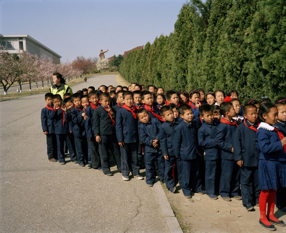 NORTH KOREA. Pyongyang. Schoolchildren on their way back from Mansu Hill. 1997 © Martin Parr / Magnum Photos.