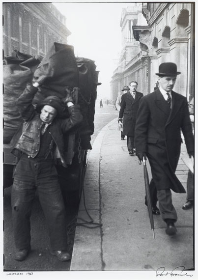 """Lot 1702ROBERT FRANK (1924)""""London 1951"""".Gelatin silver print. Printed later, probably 1970's.Image size 46.5 x 31 cm; paper size 50 x 40 cm.Entitled and fully signed below the image. On the reverse handwritten notes by Frank: """"This I think for printing RF"""". Framed.Estimate: CHF 18 000 / CHF 28 000 