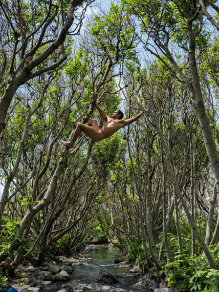 Matt Swinging Between Trees, Lost Coast, California. © Lucas Foglia, courtesy Michael Hoppen Gallery