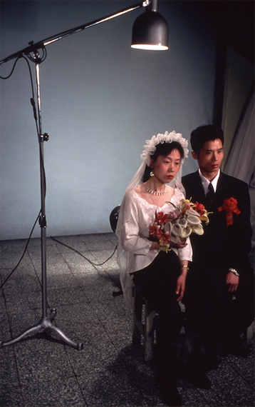 Newly-weds pose for a studio photo, Beijing, 1980. 