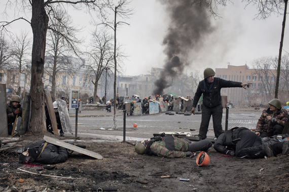 Spot News, Stories, 2nd prizeJérôme Sessini, Final fight for Maidan20 February, 2014, A protestor calls for medical assistance for a shot comrade.Magnum Photos for De Standaard