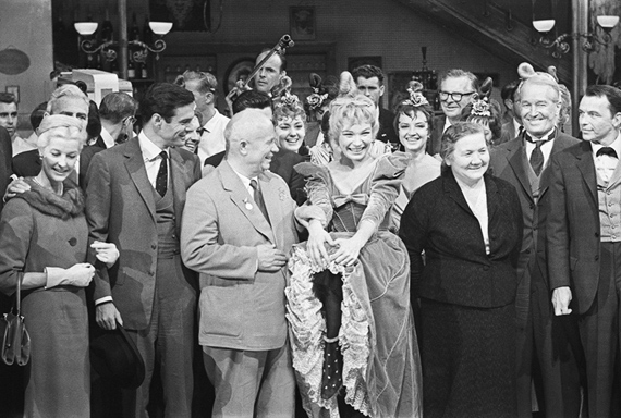 Alexander UstinovNikita Khrushchev's visit to the USA. In the foreground from right to left: Frank Sinatra, Maurice Chevalier, Nina Khrushcheva, Shirley MacLaine, Nikita Khrushchev, Louis Jourdan.19–20 September 1959