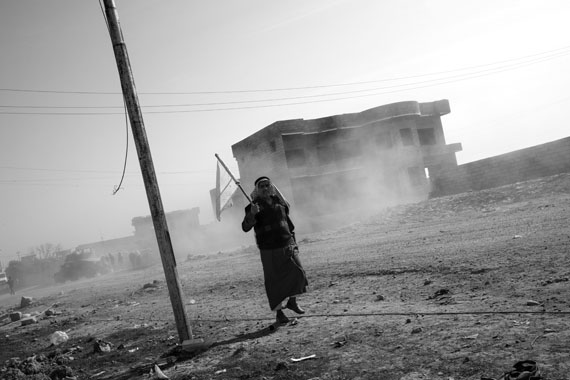 Paolo Pellegrin: IRAQ. 2016. A man fleeing from ISIS controlled areas is seen in the outskirts of eastern
