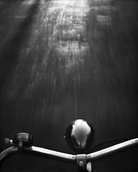 © René Groebli, Riding a bicycle freehanded, Zurich, Switzerland, 1946