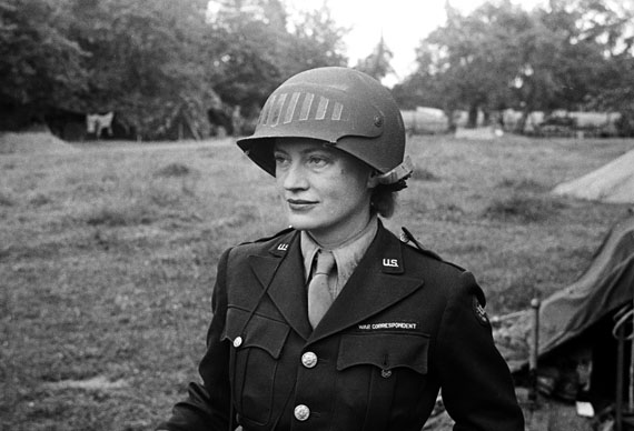 Lee Miller wearing a special helmet borrowed from U.S Army photographer Don Sykes (Sergeant), Normandy France, 1944© Lee Miller Archives, England 2020