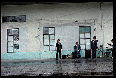 "Robert van der Hilst: ""Shanghai: 1990-1993/Businessmen Waiting for Train"" (1993), Archival Pigment Print., 