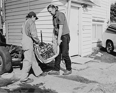 Jeff WallMen move an engine block, 2008Silver gelatin print134.6 x 170 cm53 x 67 inchesEdition of 3 + 1 APCourtesy Marian Goodman Gallery, New York, Paris