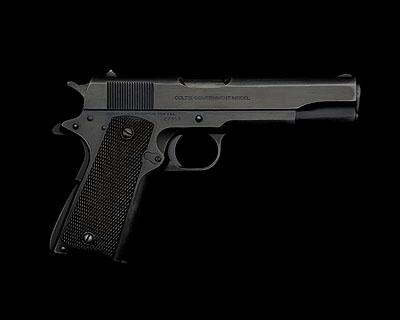 © Guido Mocafico, Guns and Roses, Colt's Government Model E, courtesy of Hamiltons Gallery