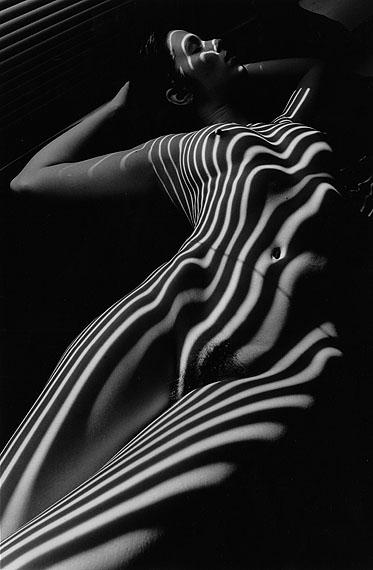 © Lucien ClergueNude Zebra, New York, 1998, printed 2001Gelatin silver print, 46.5 x 30.2 cm