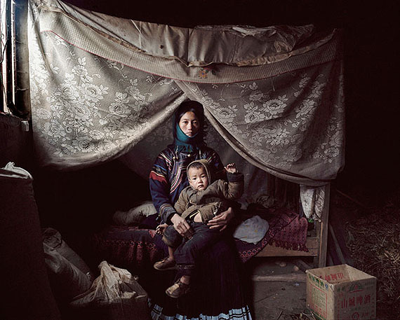 "ROBERT VAN DER HILST: ""Chinese Interiors #79:  Yi Minority Woman and Her Baby Son. Tuojue Village, Sichuan Province"" (2007) Archival pigment print. 46cm x 56cm - Ed. of 15; 67cm x 80cm - Ed. of 10; 110cm x 131cm - Ed. of 5. © Robert van der Hilst. Courtesy of m97 Gallery."