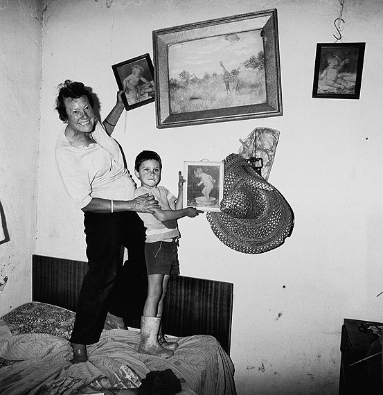 Roger Ballen, Diamond digger and son standing on bed, Western Transvaal, 1987Silver Gelatin Prints, 54cm x 51cmCourtesy the artist and Gagosian Gallery