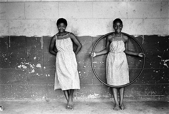 Cedric Nunn, Green sisters, on the back step of the guest house built by John Dunn, Mangete, KwaZulu Natal, 1982hand print, silver toned40,5 x 50,5 cmCedric Nunn, courtesy BaileySeippel