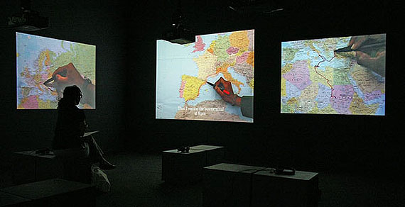 "Bouchra Khalili (Morocco/France, 1975)The mapping journey project, 2010 | Five-channel video installationThrough the routes travelled illegally by five immigrants, between Europe and Palestine, this work outlines a parallel geography, in a context of sociocultural displacement and ""clandestine existences,"" to quote philosopher Michel Foucault.© SESC_Videobrasil"