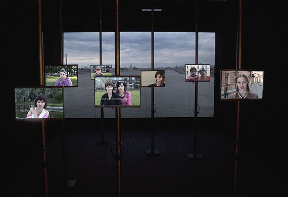 "Annica KARLSSON RIXON  / Anna Viola HALLBERGState of Mind, video installation Six 19"" open frame SD monitors (built in Media players.)w/sound (headphones), one HD projection w/sound (ambient) with separate mediaplayer, speakers. Monitors mounted on 5 cm pipes. Projector/media player in spider. Room covered in black fabric."