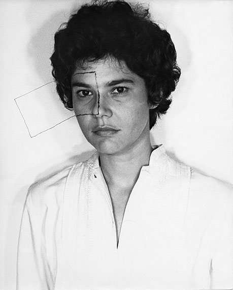LILIANA  PORTERUntitled, (Liliana Porter with  drawing)1973Fotografía blanco y negro27 x 22 1/2 inches Courtesy GALERÍA  ESPACIO MINIMO