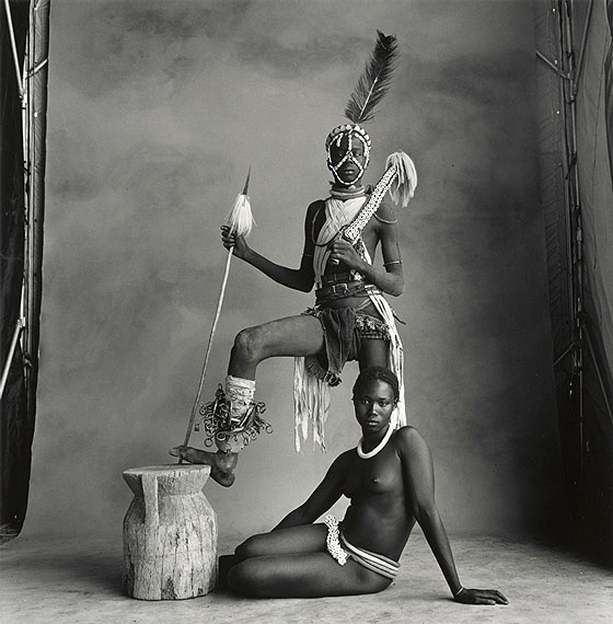 IRVING PENNStanding Warrior, Sitting Girl, Cameroon, 1969Gelatin silver print toned in selenium mounted to boardc. 45 x 43 cm  Edition of 5© The Irving Penn Foundation
