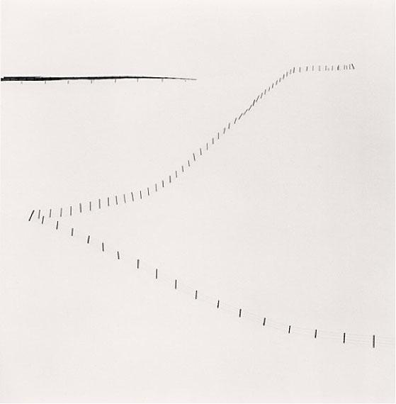"""Hillside FenceSilver gelatin print. 20cm x 20cm - Edition of 45. , Study 6, Teshikaga, Hokkaido, Japan"" (2007)© Michael Kenna. Courtesy of m97 Gallery."