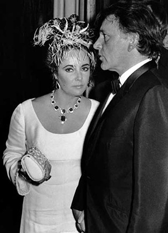 Elizabeth Taylor and Richard Burton attend the premiere party for 'A Flea in Her Ear' at Les Ambassadeurs Restaurant, October 18, 1968, Paris © Ron Galella