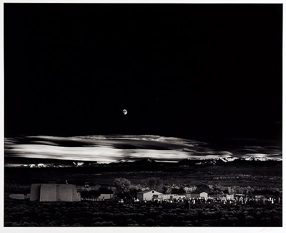 LOT 1075Ansel Adams (1902–1984) ›Moonrise, Hernandez, New Mexico‹Gelatin silver print, printed 1970s, mounted on original cardboard39,3 x 49 cm (15,5 x 19,3 in)1941
