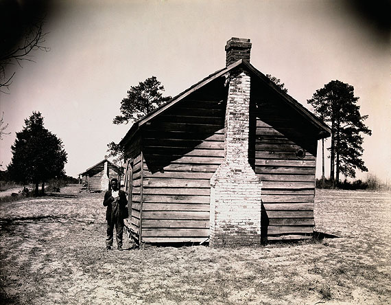 Walker Evans: Man Posing for Picture in Front of Wooden House, 1936 © Walker Evans Archive, The Metropolitan Museum of Art