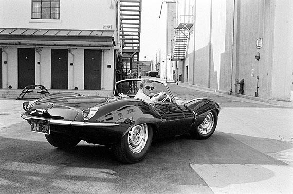 Steve McQueen in black Jaguar at studio, California, 1963. © John Dominis / Time Inc. All Rights Reserved.