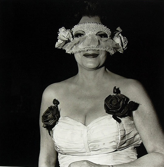 Lady at a Masked Ball with Two Roses on Her Dress NYC 1967 © Diane Arbus