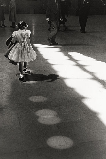 "© Louis Stettner ""Girl Dancing in Circles, Penn Station 1958"""