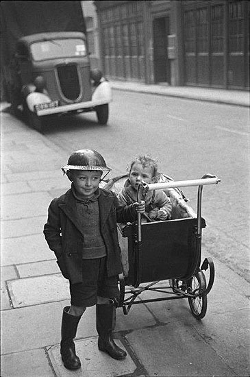 © George Rodger / Magnum Photos, G.B. ENGLAND. London. Steel helmets were worn by all who could get them. Life in London during The Blitz of World War II in1939-40. 1940.